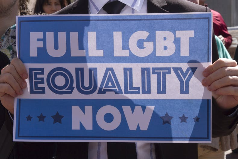 Asheville, North Carolina, USA - April 2, 2016: An activist holds a sign at a HB2 protest rally of a law that takes away the rights of the LGBTQ community.