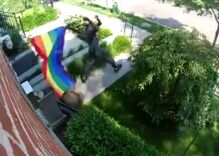 A man was caught on video tearing down a Pride flag, beating it & shouting slurs