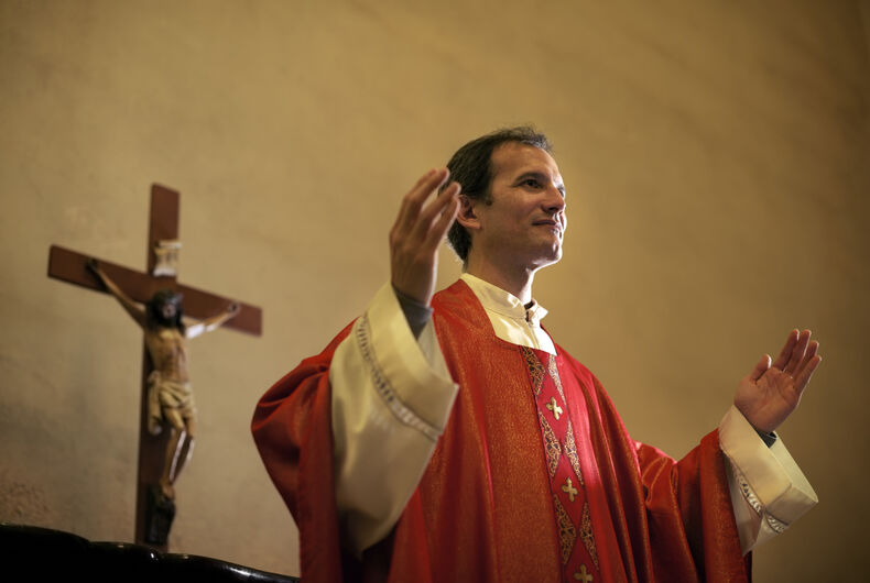 Priest with a cross