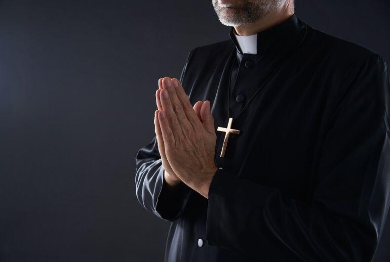 A dishy priest praying