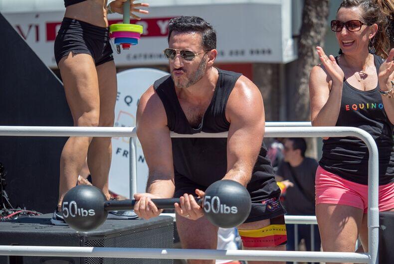 JUNE 23, 2018: Equinox employee lifting a mock 50 lb barbell during the San Francisco LGBT Pride Parade