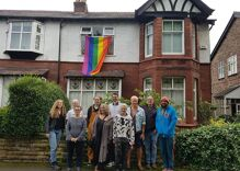A gay man got a death threat when he flew a rainbow flag. His neighbors' reaction is amazing.
