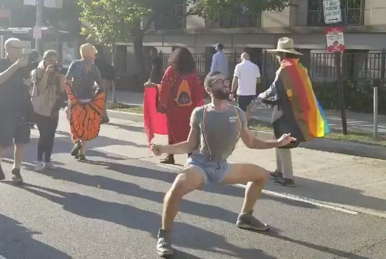 A Werk For Peace dancer struts his stuff during an environment protest in DC