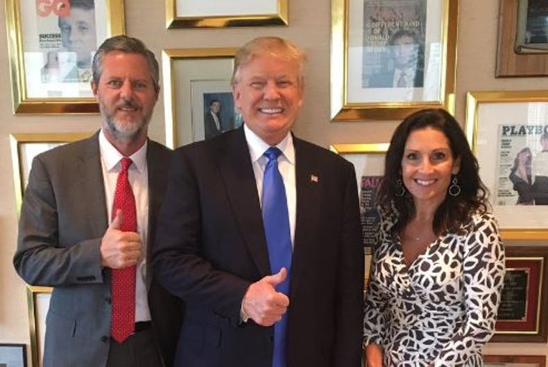 Jerry Falwell Jr. posing with Donald Trump, next to a framed copy of Playboy.