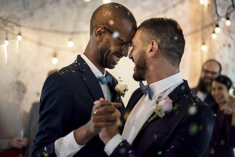 Two men dancing at a wedding