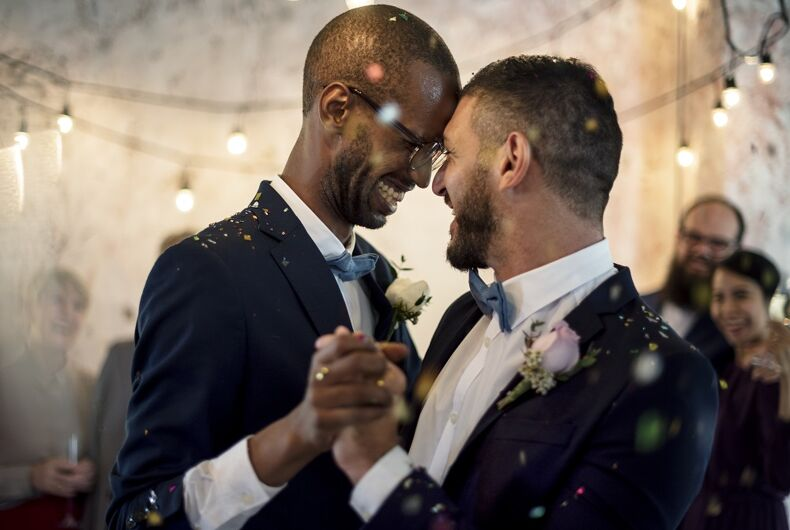Two men dancing at a wedding