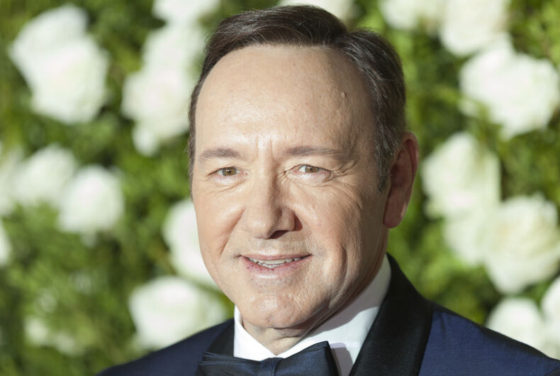 Kevin Spacey wears a tux and smiles.