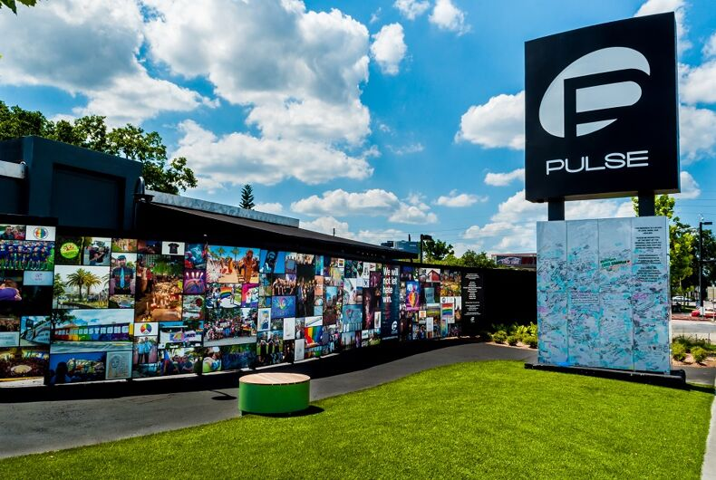 June 19, 2018 : Pulse Nightclub Interim Memorial south side Pulse sign and visitor message board, east wall photographs, and lawn.