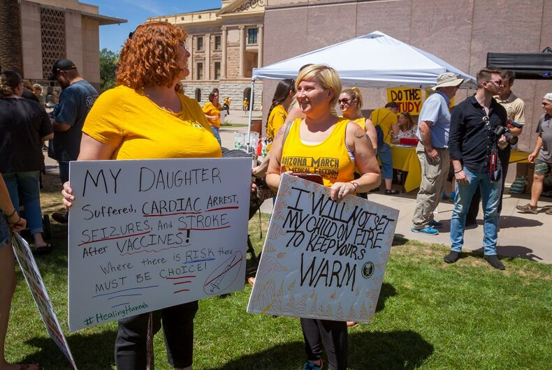 MAY 18, 2019: Two women holding signs at a demonstration against vaccinations in Arizona.