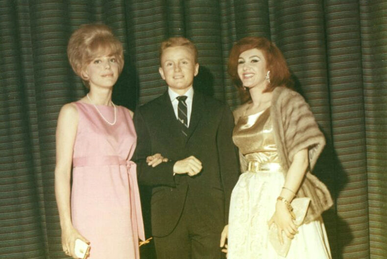 Reed Erickson with two women