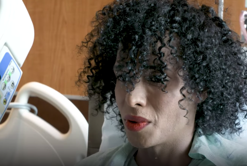 Daniela Calderon is a Latinx trans woman with black curly hair and lipstick at the hospital
