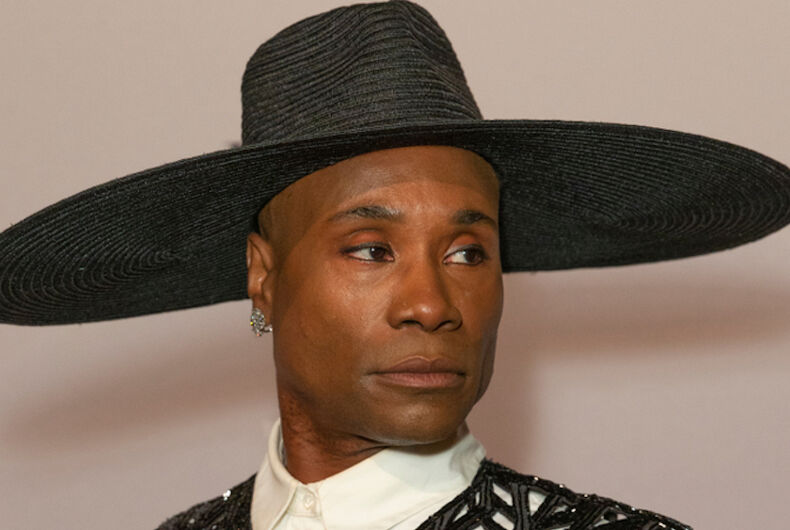 Billy Porter wears a wide brimmed black hat while serving some serious side eye.
