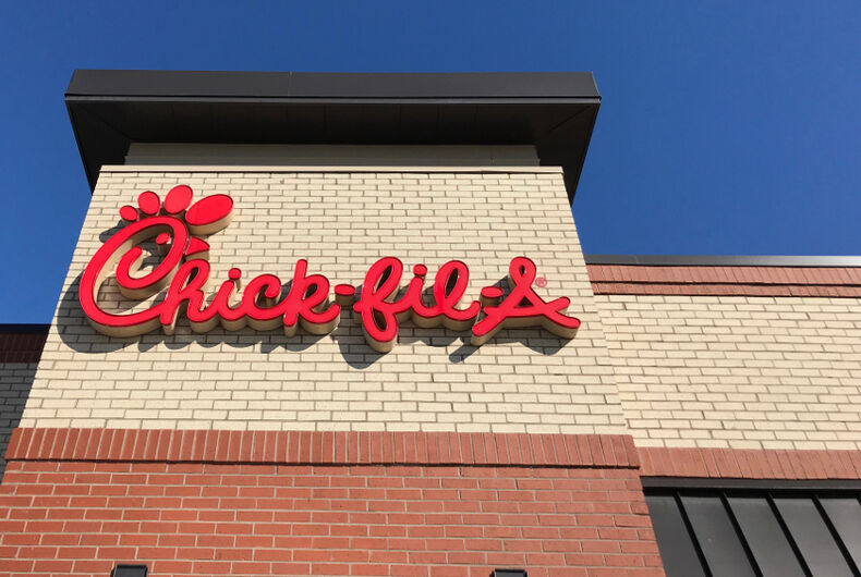 A Chick fil-A logo sits atop one of its restaurant buildings.