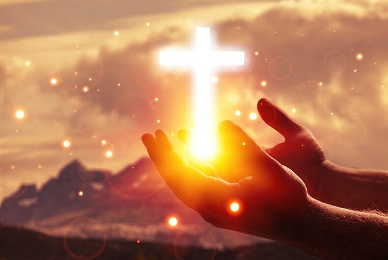 Cross and hands