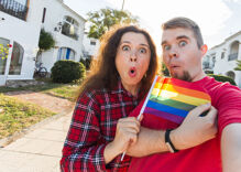 Adults handing out pride flags at a middle school have angered liberals & conservatives