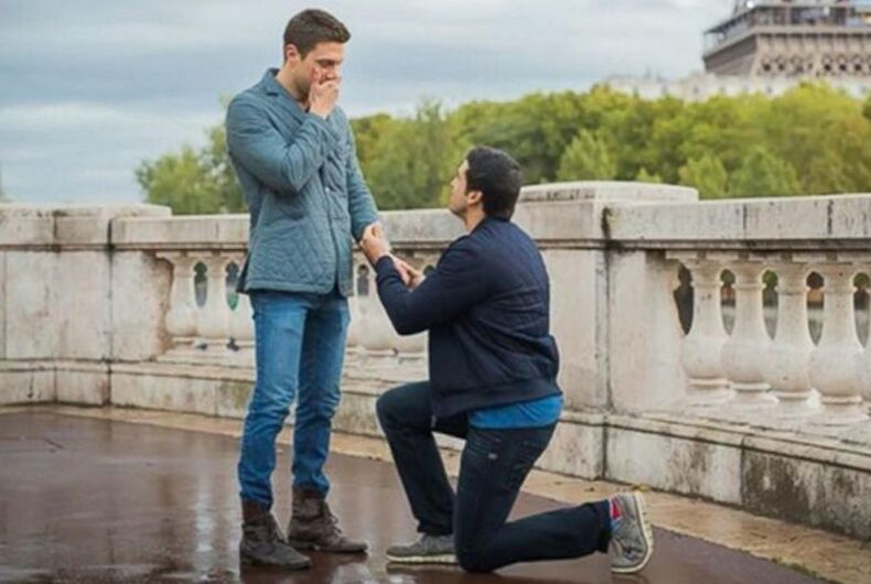 Gio Benitez proposes to Tommy DiDario near the Eiffel Tower.