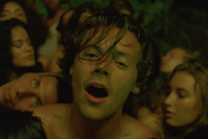Harry Styles gets caressed by men and women in his new video for the allegedly bisexual anthem