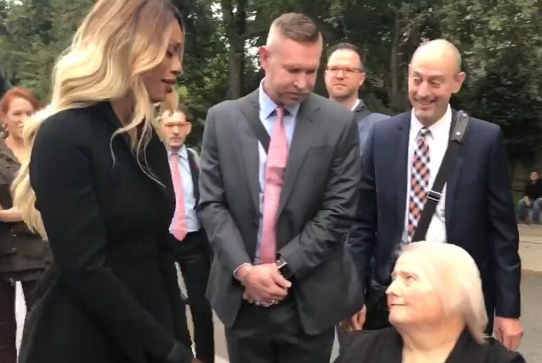 Actress Laverne Cox greets Aimee Stephens, who was fired from her job at a funeral home when she announced her transition. Her former employers say they are allowed to fire trans people because federal law doesn't protect them.
