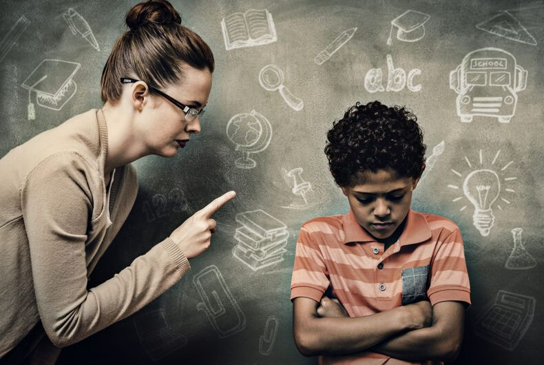 Education doodles against teacher shouting at boy in classroom (Stock)
