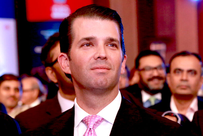 Donald Trump Jr. is a clean cut white guy in a suit and pink tie.