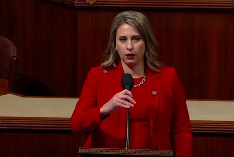Former Democratic Rep. Katie Hill announces her resignation in the U.S. House chamber wearing a red suit.