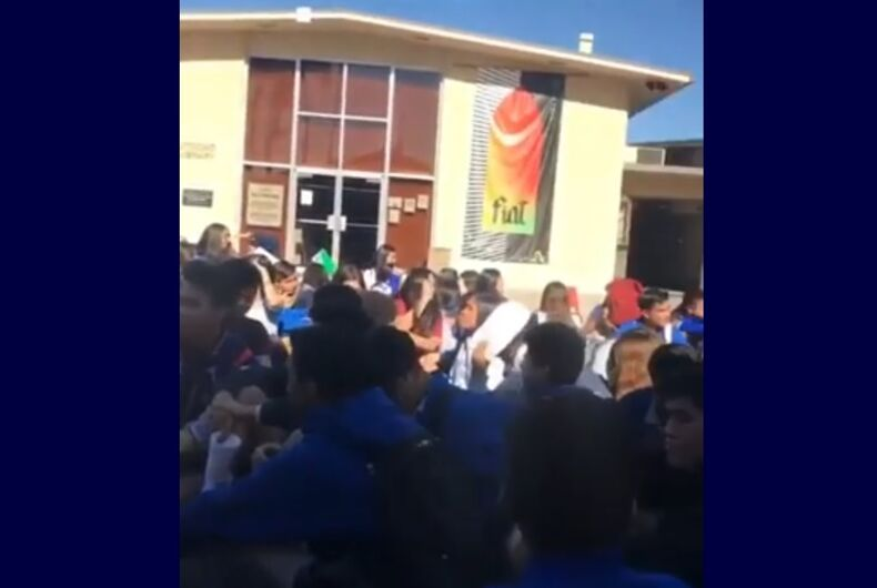 Students sat outside of Bishop Amat Memorial High School on Friday in protest of how the school treated a lesbian student.