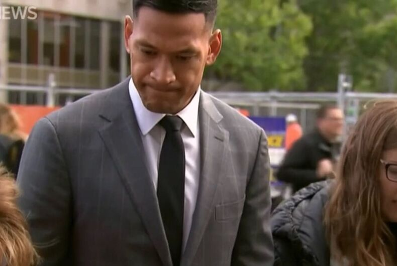 Israel Folau, praying outside of a hearing before the High Court of Australia.