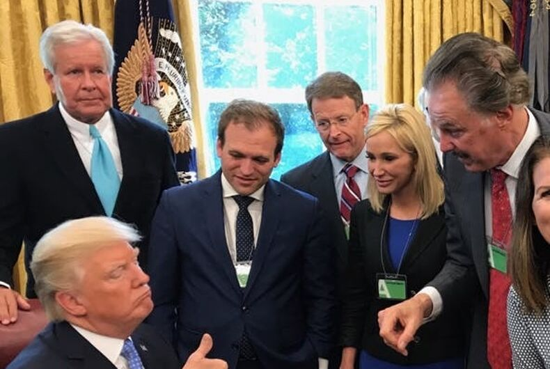 Johnnie Moore standing just to the left of Donald Trump.