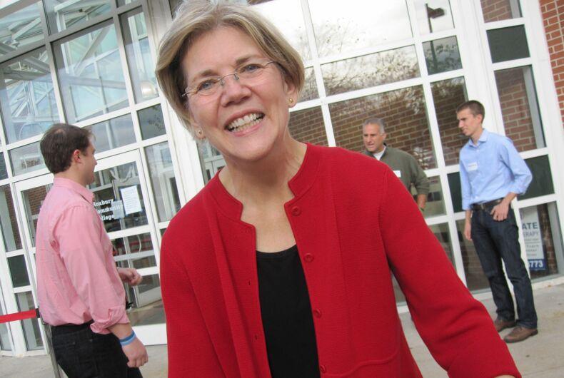 Sen Elizabeth Warren shakes hand with supporters in Boston MA on Nov 13 2011.