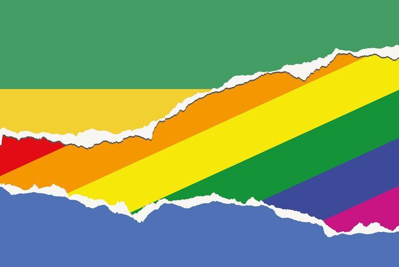 Gabon's flag torn to show the rainbow flag