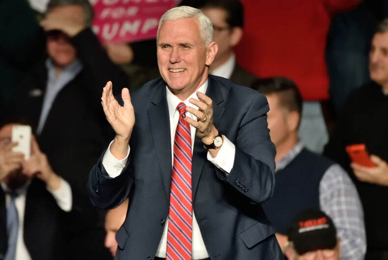 Vice President-Elect Mike Pence applauds as he comes on stage to deliver a speech to a large crowd at a Thank You rally held at the Giant Center.