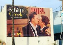A TV show is advertising with a giant gay kiss on a billboard in Los Angeles
