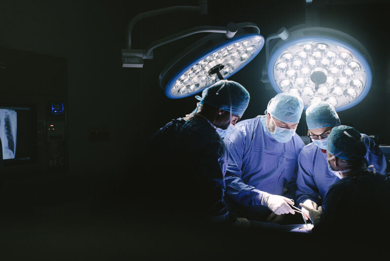 surgeons completing a testicular transplant procedure.