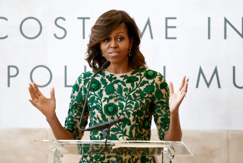 First Lady of the United States Michelle Obama at ribbon cutting ceremony for Anna Wintour Costume Center Grand Opening at Metropolitan Museum of Art on May 5, 2014 in New York City.