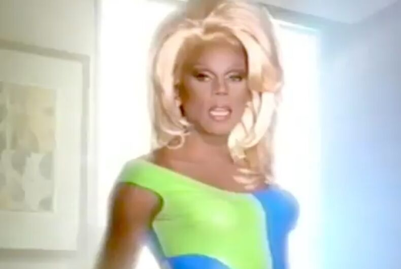 RuPaul in a blue and green dress