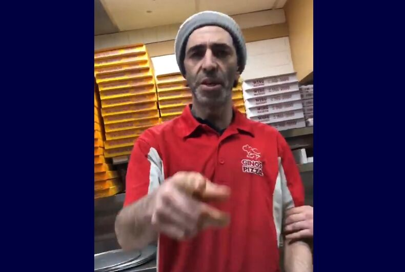 The Gino's pizza worker pointing