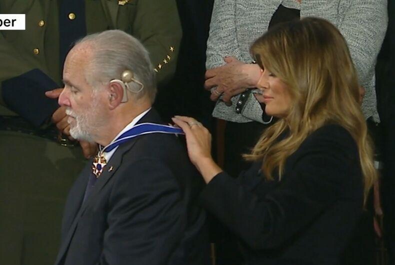 Melania Trump putting the Medal around Rush Limbaugh's neck.