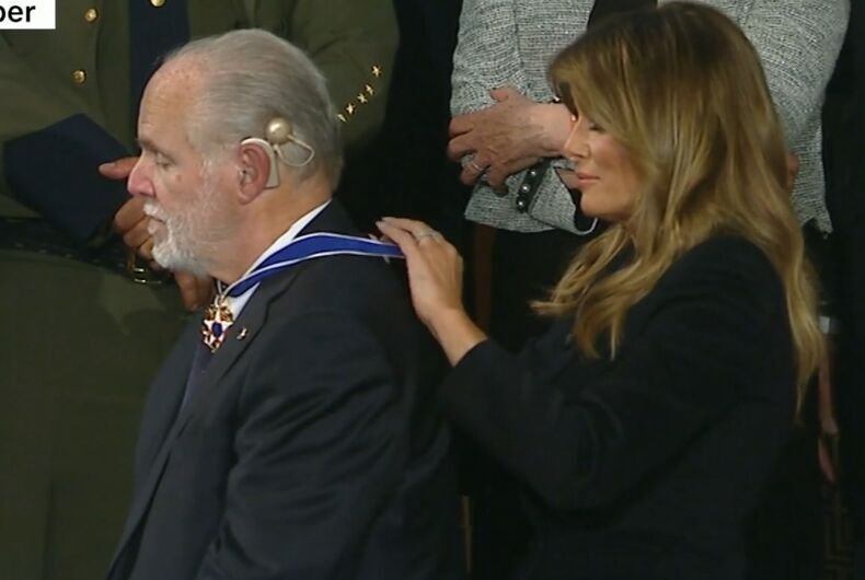 Melania Trump putting the Medal around Rush Limbaugh's neck.