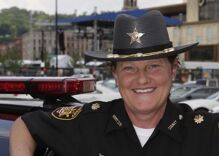 The sheriff fired her because she's a lesbian so she ran against him. She'll be the new sheriff now.