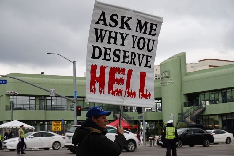 LOS ANGELES, FEB 26TH, 2017: A religious protester promises