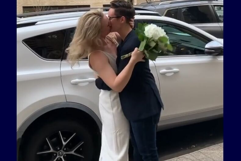 Reilly Jennings and Amanda kissing at their wedding