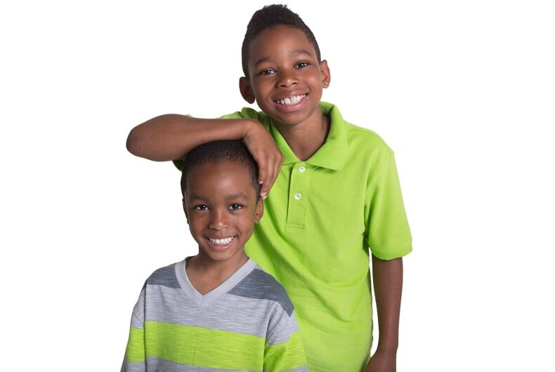 Two brothers standing together smiling