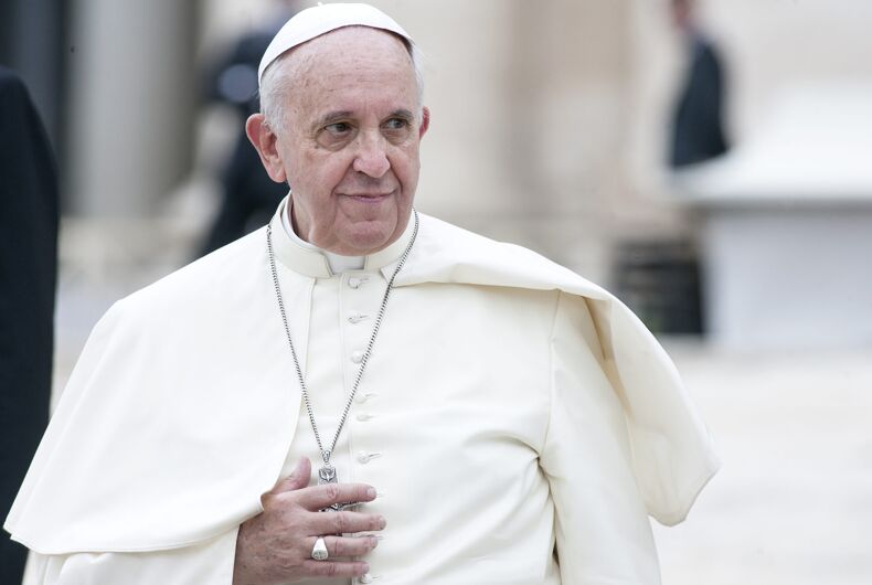 Pope Francis greets pilgrims during his weekly general audience in St Peter's square at the Vatican on September 10, 2014.