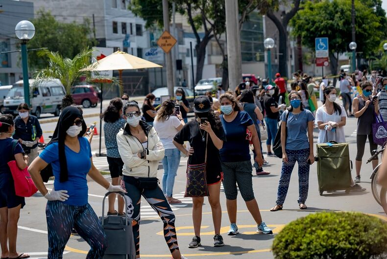 A crowded street on a women's day in Peru, which implemented the same gendered policy.