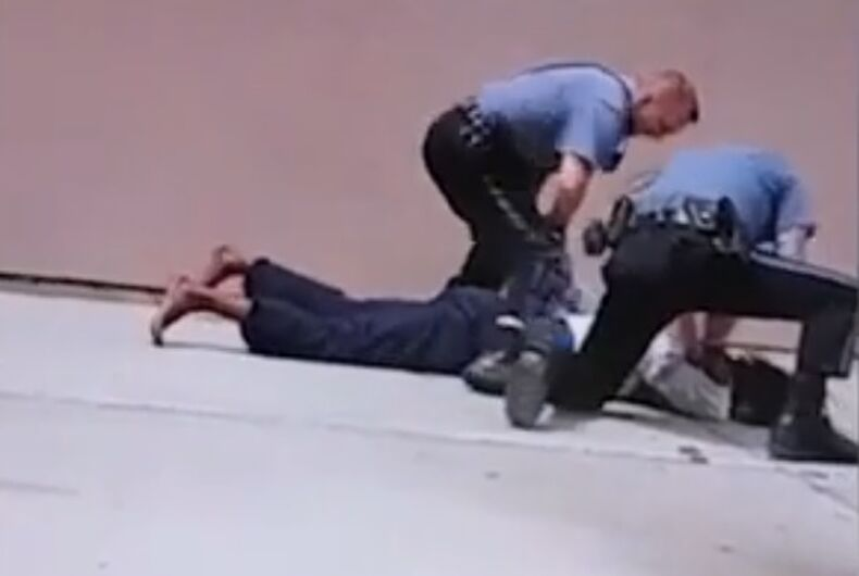 Officers appear to beat Hill's head against the pavement.