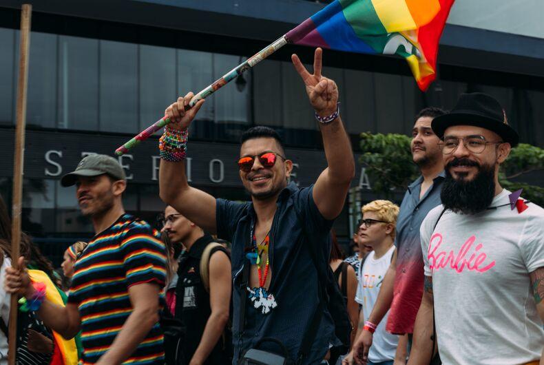 San Jose, Costa Rica 7/1/18: Unidentified participants waving flag in gay pride parade