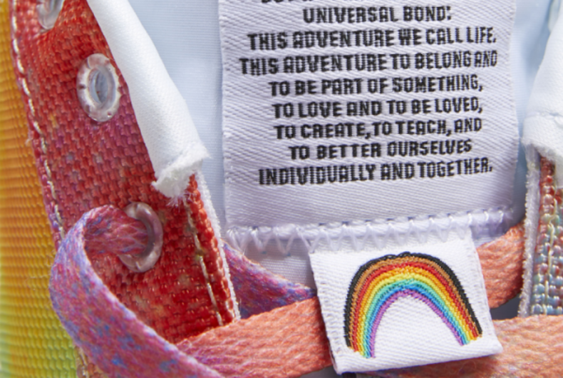 A closeup photo of one of Reebok's new Pride-Inspired rainbow sneakers, with the tongue of the show saying
