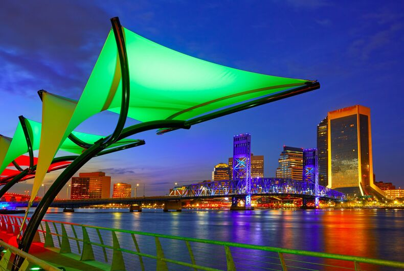 Rainbow lights from the Jacksonville skyline reflect on the water