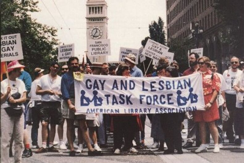 A group of librarians holding up a