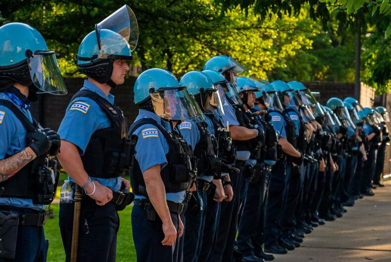 June 4 2020: Chicago Police Department officers watch a police brutality and racial justice protest.